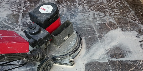 Black Marble Tile Being Restored